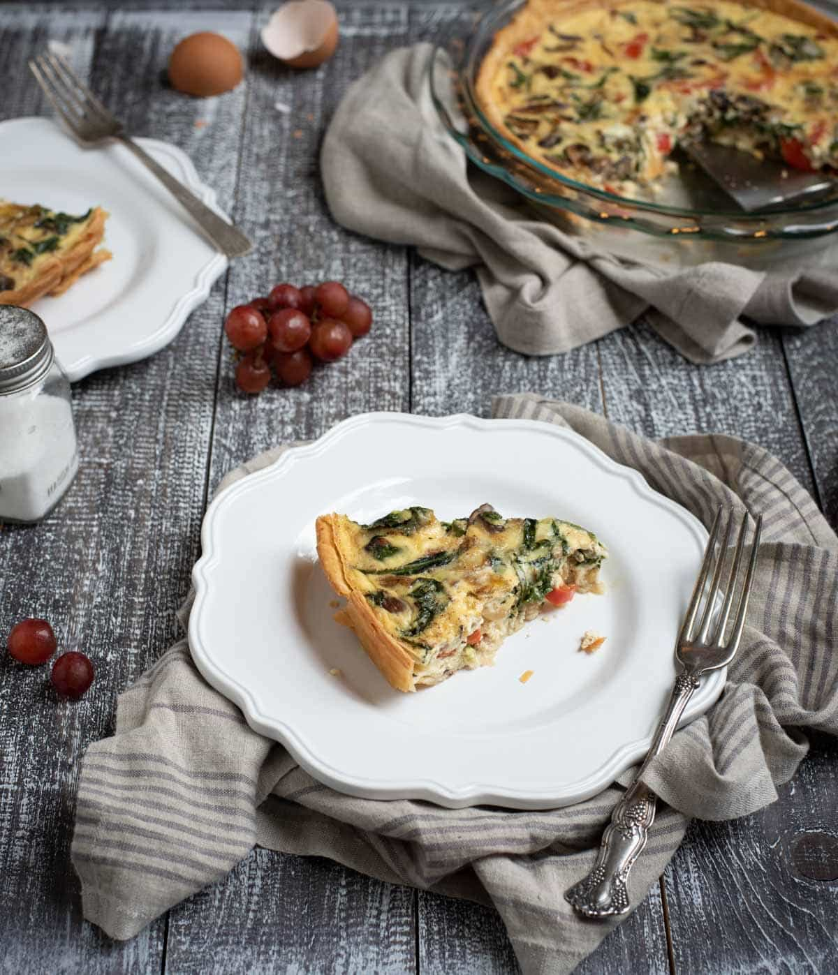 Plate with vegetable quiche slice
