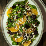 Delicious and impressive arugula salad tossed with a tangy balsamic vinaigrette and plated with orange slices, toasted pecans, feta and roasted beets.