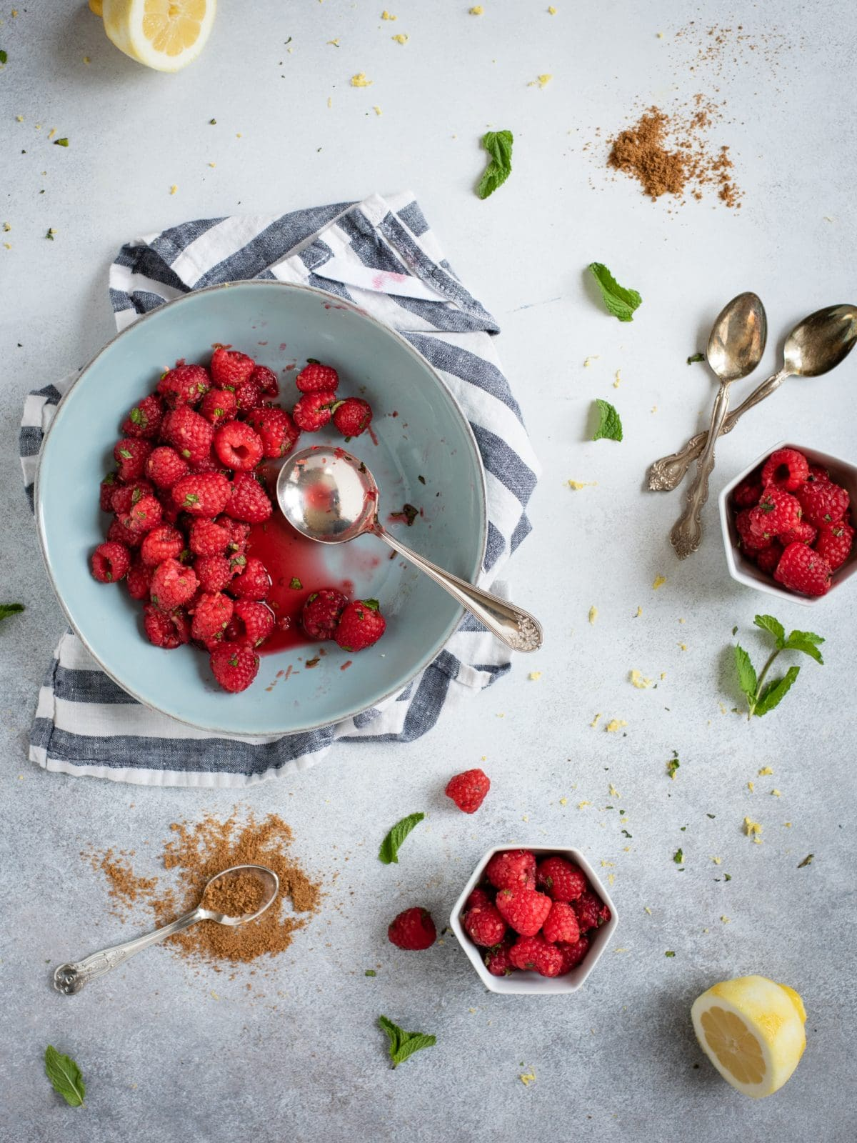 Overhead picture of Raspberries with lemon zest and mint