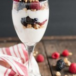This light and healthy yogurt parfait can be made in five minutes or less with over 14 grams of protein, 9 grams of fiber, and only three ingredients! - Feasting Not Fasting