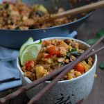 Thai fried brown rice that's loaded with veggies to lighten up without loosing any of the tasty flavor and spice that we all love and crave.