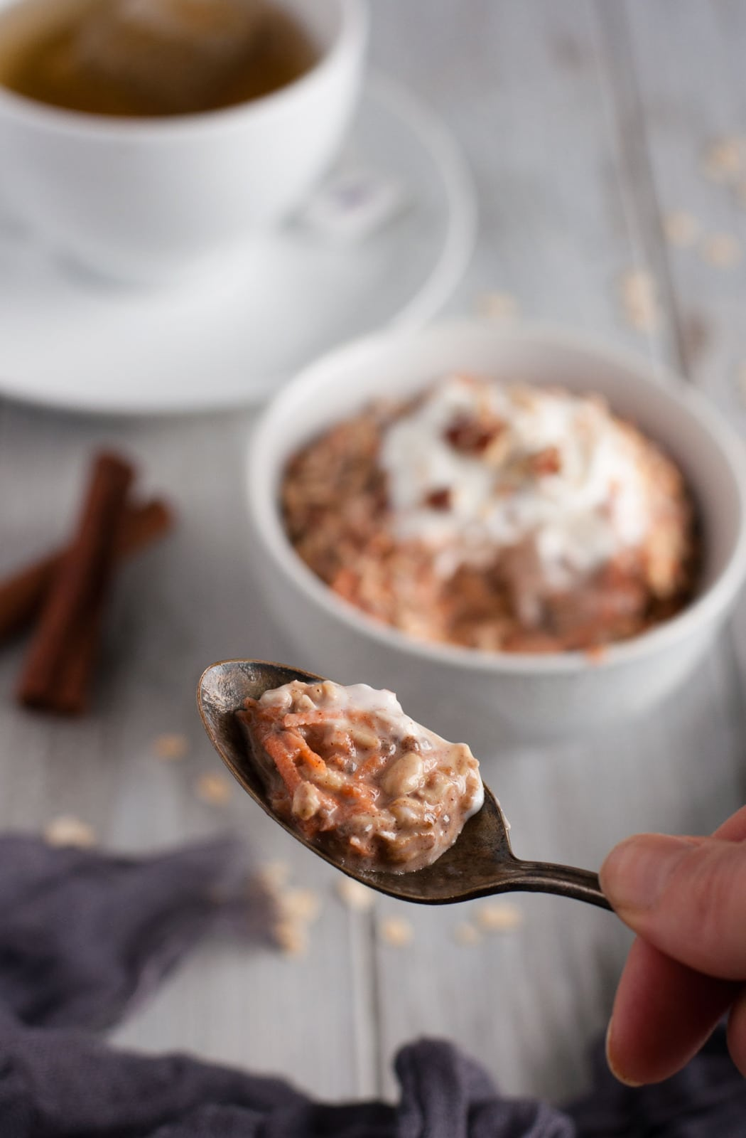 Carrot cake overnight oats are a healthy 350 calorie breakfast that tastes just enough like the favorite dessert to make breakfast seem like a treat.