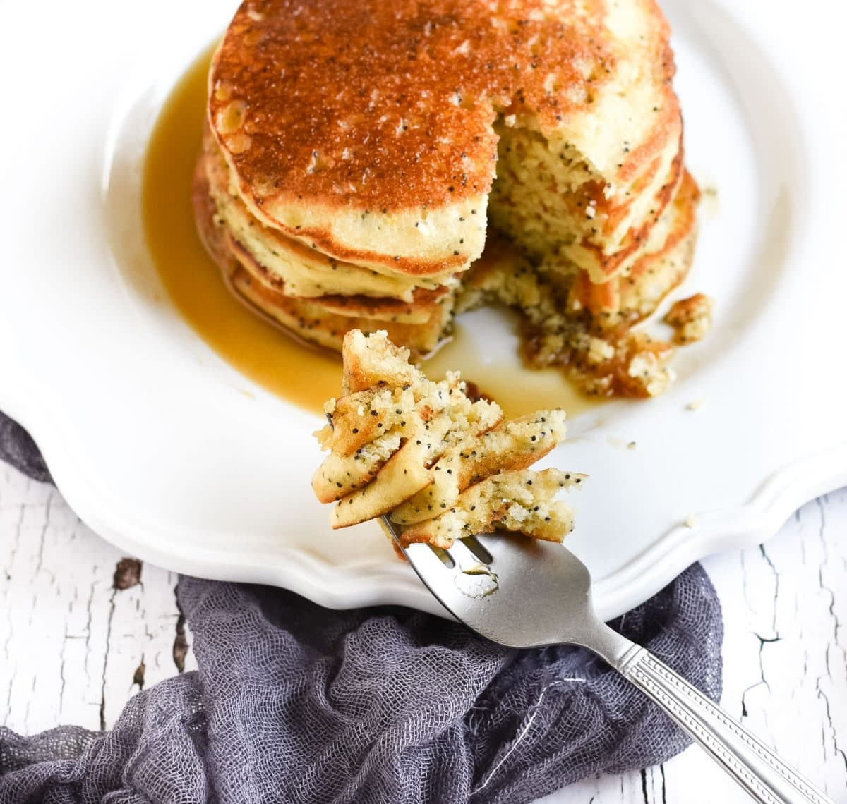 Picture of poppy seed pancakes with bite on fork