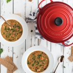 overhead picture of chicken paprika soup and le creuset pot