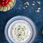 Photo of whipped feta with herbs on blue serving bowl