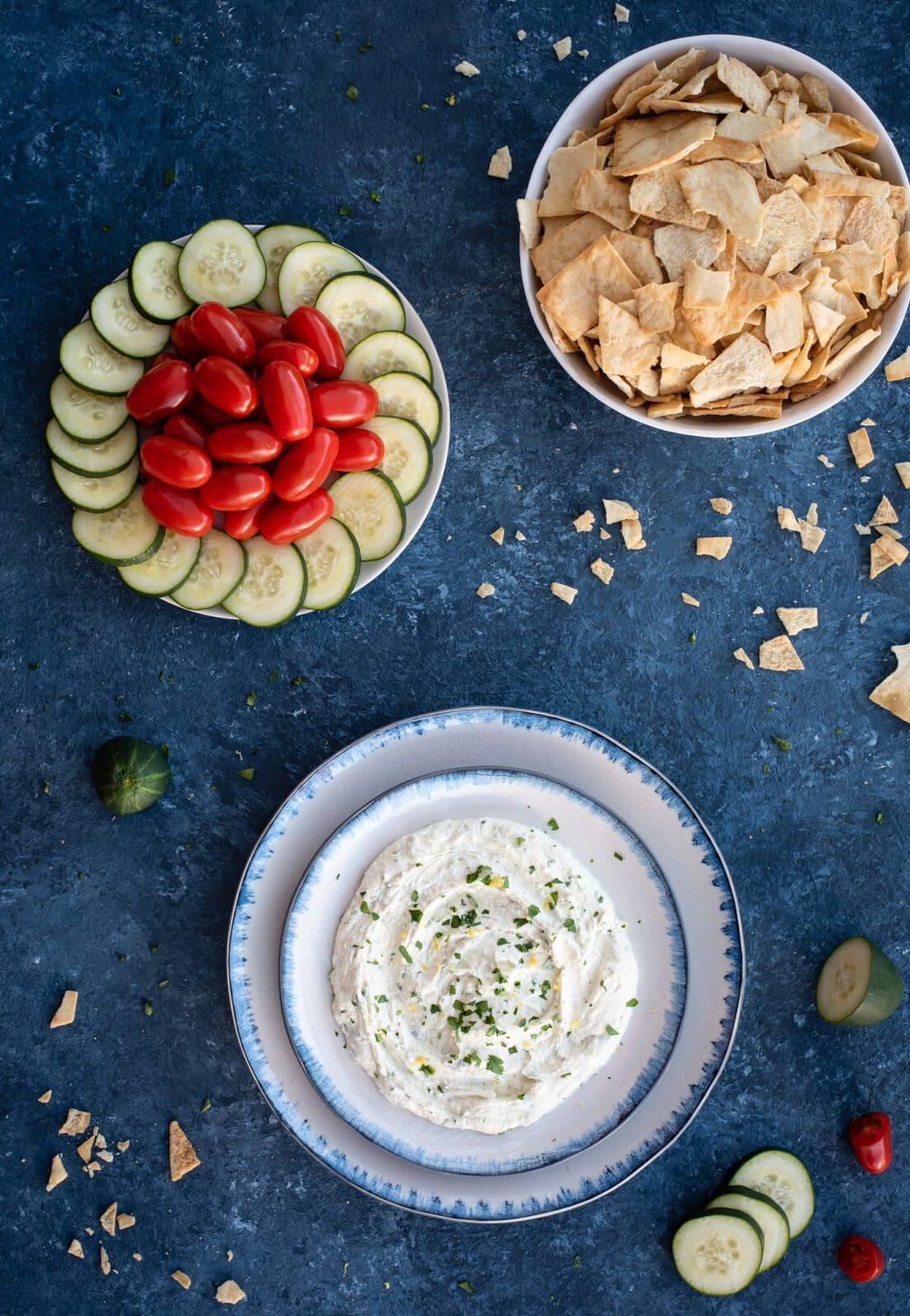 Picture of whipped feta with herbs, crackers, and vegetables
