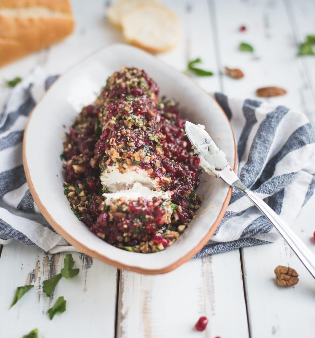 Photo of sliced cranberry herb goat cheese log