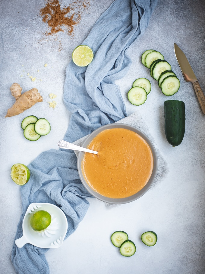 Overhead picture of peanut sauce with cucumber slices