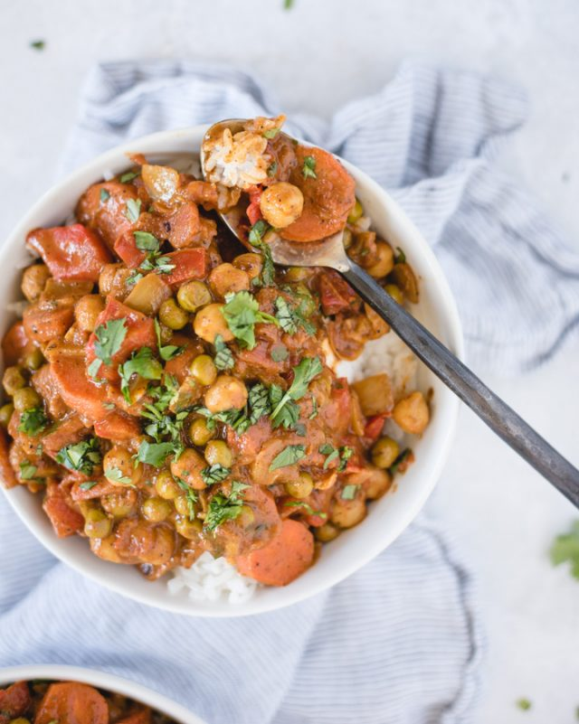 Bowl of chickpea curry with spoonful of curry resting on the edge